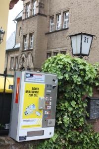 Street-side cigarette vending machine