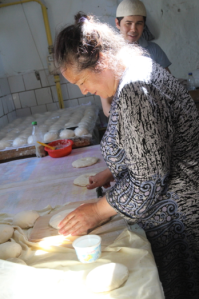 hard at work in the bakery, Uzbekistan