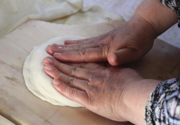 kneading Uzbek bread