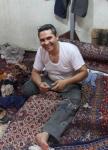 Repairing carpet, Iran