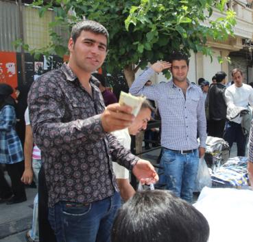Selling clothes, Tehran, Iran