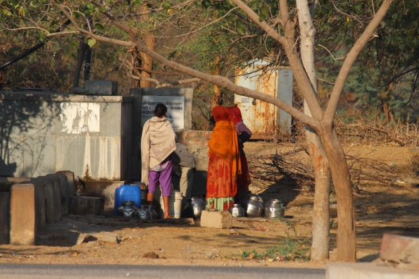 collecting water, India