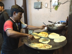 adding egg to roti