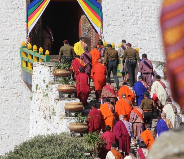 King of Bhutan in yellow scraf
