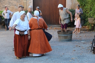 Medieval dance display with grape stomper