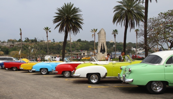 Vintage cars in Cuba waiting for passengers