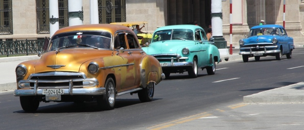 Three vintage cars in Cuba