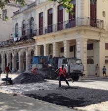 spreading asphalt in Cuba
