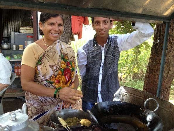 Indian mother and son with food stall