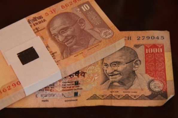 1000 rupees, in 10s and a single 1000