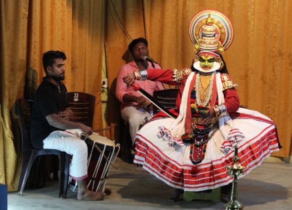 Kathakali dancer and musicians