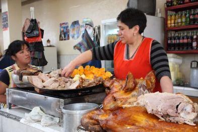 Serving pork, Ecuador