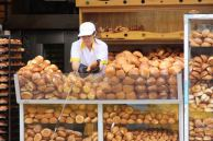 Serving bread, Ecuador