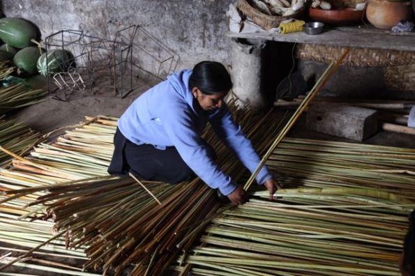 Weaving a mat, Ecuador