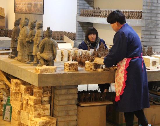 Making pottery, China