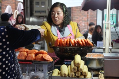 Selling persimmon cakes, China