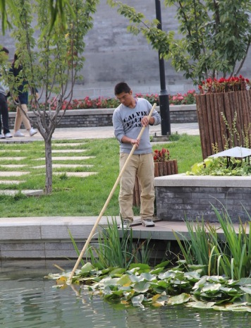 Cleaning a pond, China