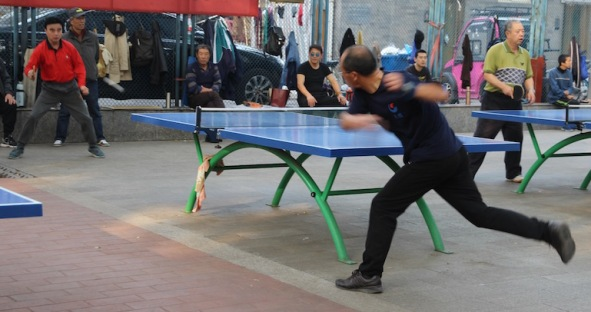 Playing table tennis, China