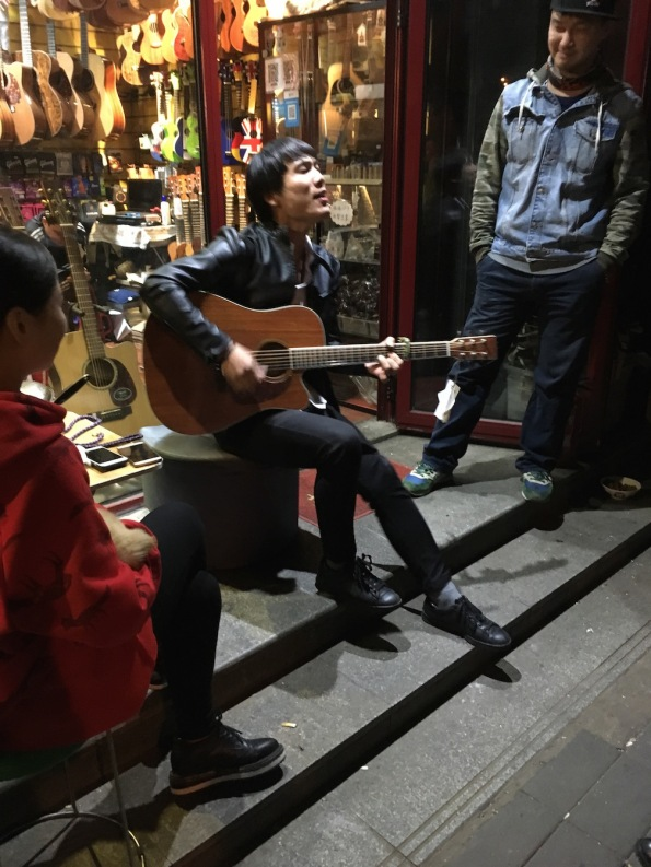 Playing a guitar, China