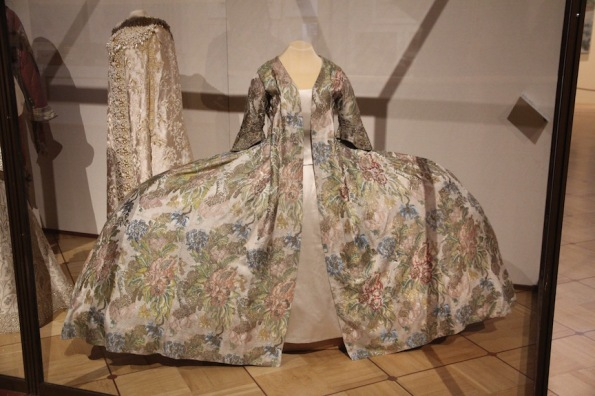 Dress with a watteau pleat