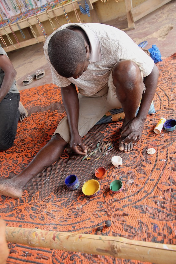Decorating a bead in the Ivory Coast