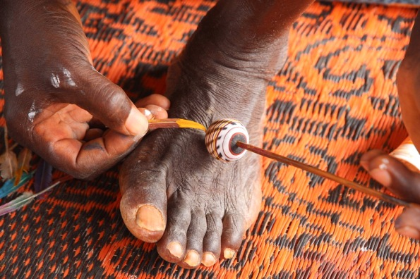 Painting a bead in the Ivory Coast