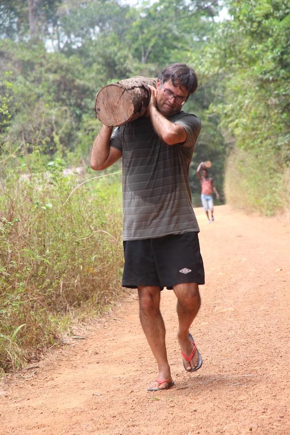 Carrying logs in Sierra Leone