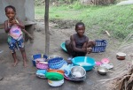 Washing dishes, Byama, Sierra Leone