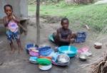 Washing dishes, Byama, Sierra Leone