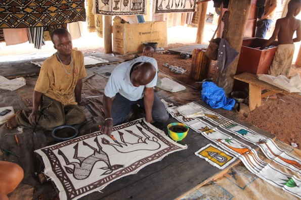 Painting Korhogo cloth
