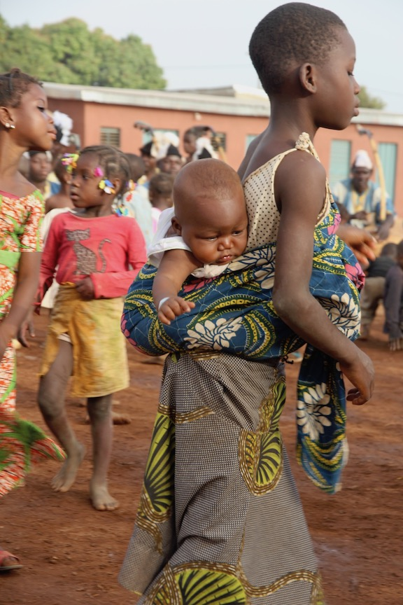 Carrying a baby, Ivory Coast